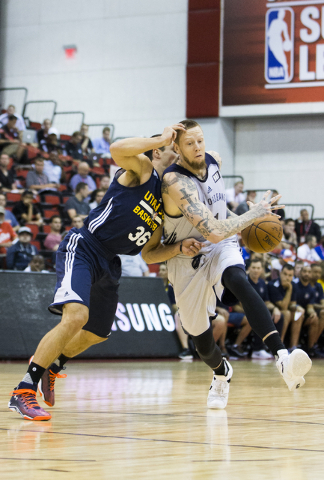New Orleans Pelicans forward Nick Minnerath (21) drives past Utah Jazz guard Aaron Craft (36) during the NBA Summer League tournament at Cox Pavilion at UNLV on Sunday, July 10, 2016, in Las Vegas ...
