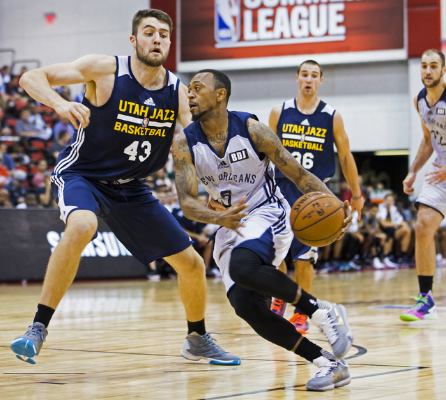 New Orleans Pelicans guard Ryan Boatright (5) drives past  Utah Jazz center Mike Tobey (43) during the NBA Summer League tournament at Cox Pavilion at UNLV on Sunday, July 10, 2016, in Las Vegas.  ...