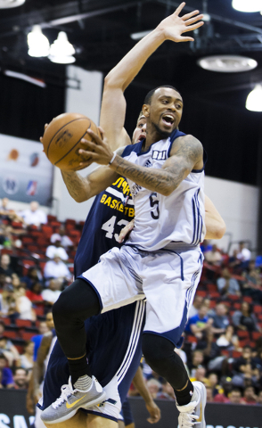 New Orleans Pelicans guard Ryan Boatright (5) makes a no look pass around Utah Jazz center Mike Tobey (43) during the NBA Summer League tournament at Cox Pavilion at UNLV on Sunday, July 10, 2016, ...
