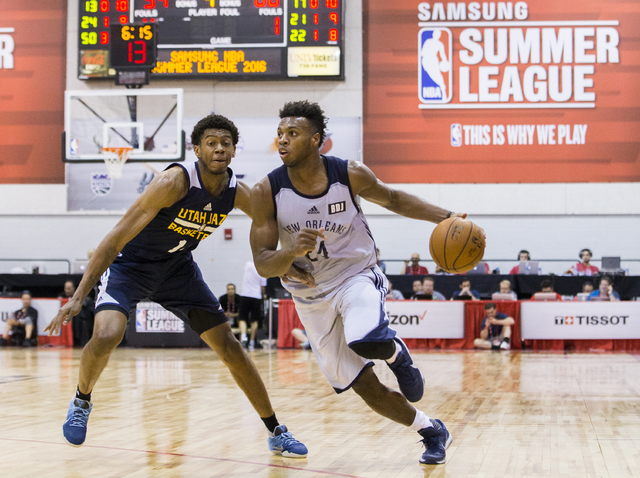 New Orleans Pelicans guard Buddy Hield (24) drives around Utah Jazz guard Tyrone Wallace (13) during the NBA Summer League tournament at Cox Pavilion at UNLV on Sunday, July 10, 2016, in Las Vegas ...