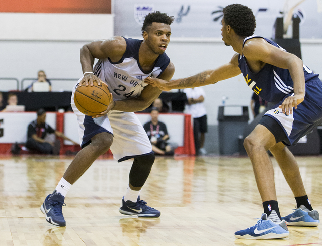 New Orleans Pelicans guard Buddy Hield (24) looks to drive past Utah Jazz guard Tyrone Wallace (13) during the NBA Summer League tournament at Cox Pavilion at UNLV on Sunday, July 10, 2016, in Las ...