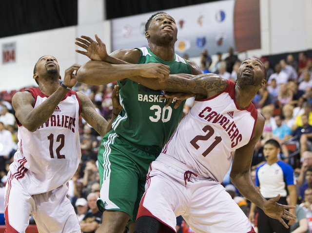 Cleveland Cavaliers guard Jordan McRae (12) and forward Cory Jefferson (21) box out Boston Celtics forward Guerschon Yabusele (30) during the NBA Summer League tournament at Cox Pavilion at UNLV o ...