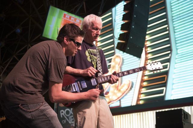 Robby Krieger of The Doors, right, and his son, Waylon Krieger, perform during the Rock of Vegas concert series at Fremont Street Experience in Las Vegas on Saturday, July 23, 2016. (Jason Ogulnik ...