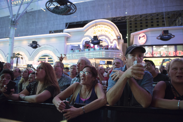 Fans sing along as Robby Krieger of The Doors performs during the Rock of Vegas concert series at Fremont Street Experience in Las Vegas on Saturday, July 23, 2016. (Jason Ogulnik/Las Vegas Review ...