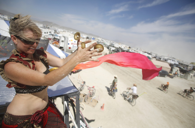 "Paulina Carey dances during the Burning Man 2014 ""Caravansary"" arts and music festival in the Black Rock Desert near Reno, Aug. 30, 2014. (Jim Urquhart/Reuters)"