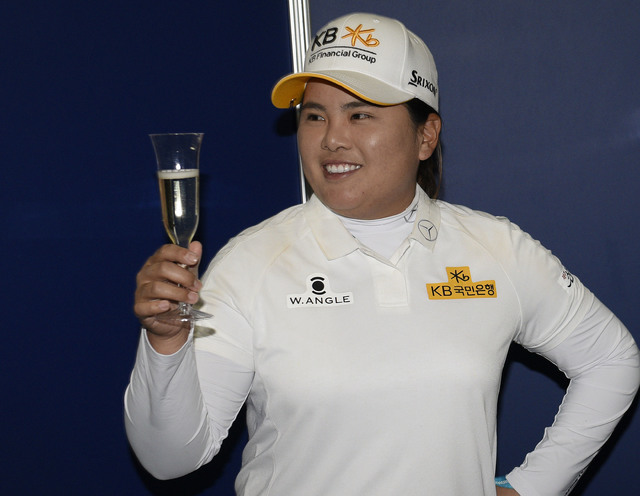 Jun 9, 2016; Sammamish, WA, USA; Inbee Park celebrates with a glass of champagne as she is honored for becoming eligible for the LPGA Hall of Fame after the first round of the KPMG Women's PGA Cha ...