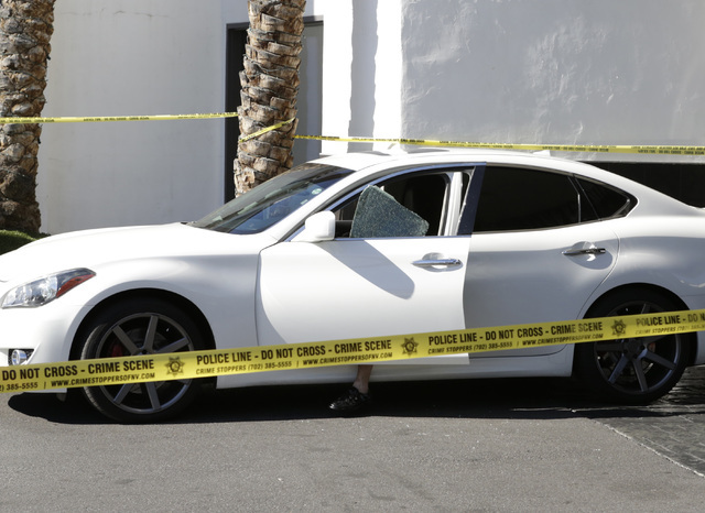 Retired police officer from New York, Neil Levine, sits in his vehicle as Las Vegas police investigate an attempted armed robbery outside the Rumor Boutique Hotel at 455 E. Harmon Ave., where Levi ...