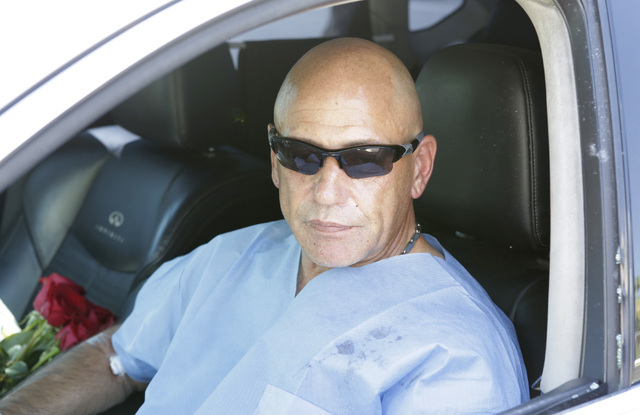 Retired police officer from New York City Neil Levine sits in his vehicle as he speaks to the media on Tuesday, July 19, 2016, outside the Rumor Boutique Hotel, 455 E. Harmon Ave. Levine was shot  ...