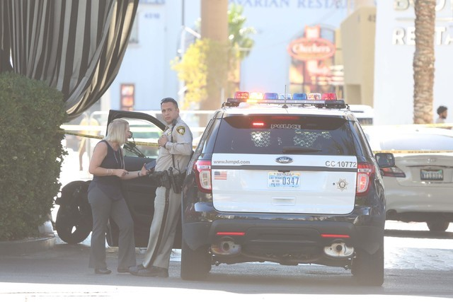 Las Vegas police investigate an attempted armed robbery where one man was shot and wounded at the Rumor Boutique Hotel, 455 E. Harmon Ave., Tuesday morning, July 19, 2016. (Bizuayehu Tesfaye/Las V ...