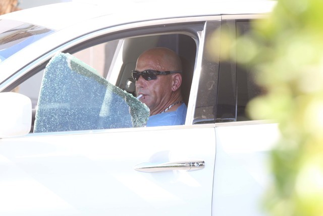 Retired police officer from New York City Neil Levine sits in his vehicle as Las Vegas police investigate an attempted armed robbery outside the Rumor Boutique Hotel at 455 E. Harmon Ave., where L ...