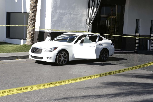 A man was shot and wounded as he sat in his car at the Rumor Boutique Hotel, 455 E. Harmon Ave., Tuesday morning, July 19, 2016. (Bizuayehu Tesfaye/Las Vegas Review-Journal Follow @bizutesfaye)