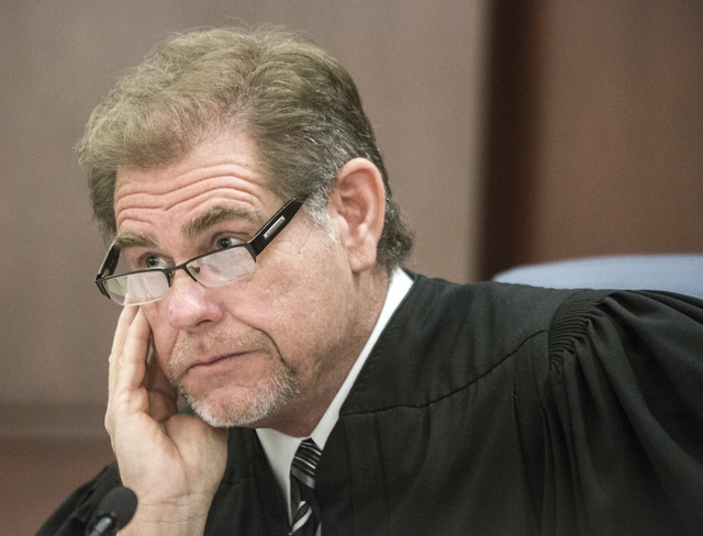 Chief Justice Ron D. Parraguirre of the Nevada Supreme Court. The entire Court recused itself from hearing an appeal between a lender and a developer because the developer has ties to company buil ...