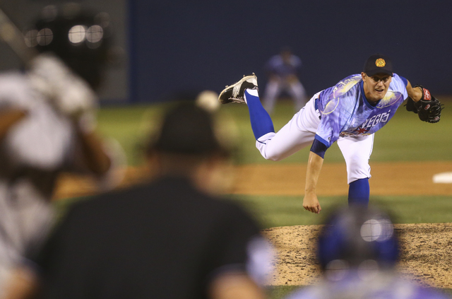 Las Vegas 51s player Paul Sewald pitches against the El Paso Chihuahuas at Cashman Field in Las Vegas in May. (Chase Stevens/Las Vegas Review-Journal Follow @csstevensphoto)
