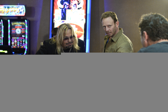 Vince Neil, left, and Ian Ziering appear on the Stratosphere set of SHARKNADO: THE 4TH AWAKENS -- Pictured: -- (Photo by: Bryan Steffy/Syfy)
