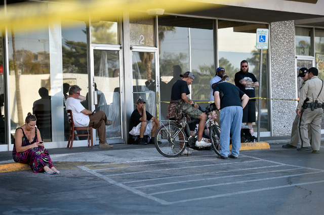 People wait while Las Vegas police investigate the scene of a shooting at 2204 W. Charleston Blvd. Monday, July 25, 2016, in Las Vegas. David Becker/Las Vegas Review-Journal Follow @davidjaybecker