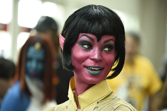 Sara Moni, dressed as the World of Warcraft's Sinestra, poses for photographers on day three of the Comic-Con International held at the San Diego Convention Center Saturday July 23, 2016 in San Di ...