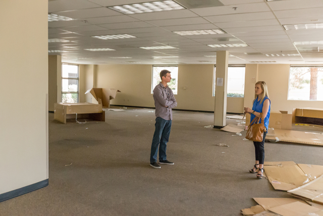 Allegiant Air public relations specialist Brandon Myers, left, speaks with Make-a-Wish marketing specialist Kellie Wyatt inside the future Make-a-Wish location at 9950 Covington Cross Drive in Las ...