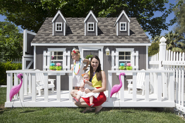 Interior designer Jannicke Ramso, owner of Tiny Little Pads, poses for a portrait with daughters Nahla, 3, and Miliah, 11 months, inside a playhouse she designed and her husband helped build at th ...