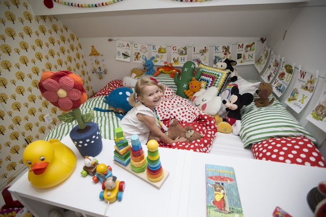 Nahla Ramso, 3, daughter of interior designer Jannicke Ramso, owner of Tiny Little Pads, sits inside her room designed by her mother April 12. Erik Verduzco/View file photo