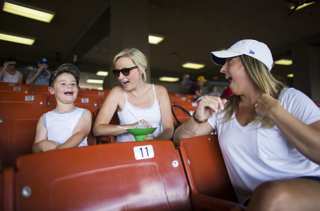 Nicole Smoker, right, smiles as Gaige Ashley, son of Las Vegas 51s catcher Nevin Ashley, watches as his dad goes up to bat against Sacramento at Cashman Field  in Las Vegas on Tuesday, June 28, 20 ...