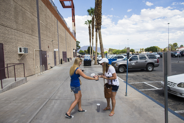 Nicole Smoker, right, says goodbye to a friend at Cashman Field following a Las Vegas 51s game against the Sacramento River Cats in Las Vegas on Tuesday, June 28, 2016. Smoker's husband, Josh, is  ...