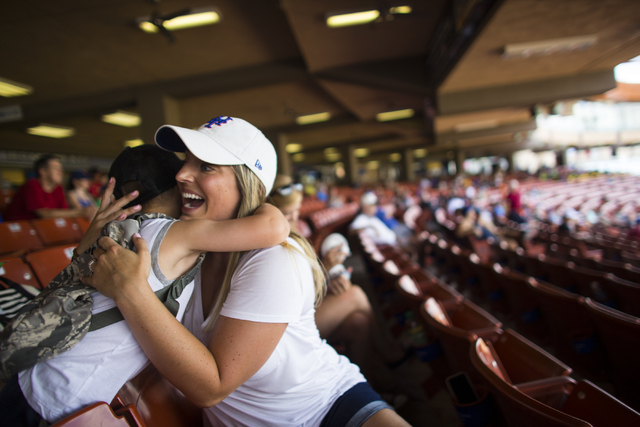 Nicole Smoker, right, hugs Gaige Ashley, son of Las Vegas 51s catcher Nevin Ashley, as the Las Vegas 51s play against the Sacramento River Cats at Cashman Field  in Las Vegas on Tuesday, June 28,  ...