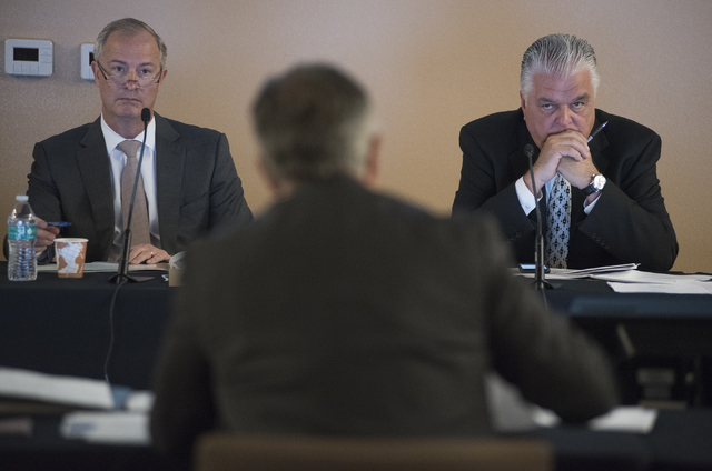 Southern Nevada Tourism Infrastructure Committee members Steve Hill, left, and Steve Sisolak, right, listen to Clark County Sheriff Joseph Lombardo, center, during a meeting about financing additi ...