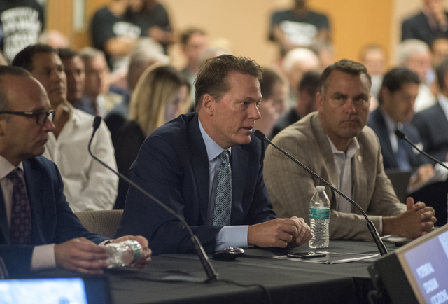 Developer for Majestic Realty Craig Cavileer, center, speaks to the Southern Nevada Tourism Infrastructure Committee during a meeting about potential stadium sites at the UNLV Stan Fulton-Internat ...