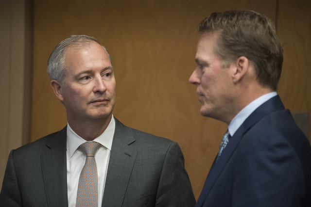 Developer for Majestic Realty Craig Cavileer, right, speaks to Steve Hill, chairman of the Southern Nevada Tourism Infrastructure Committee, during a meeting about potential stadium sites at the U ...