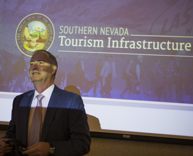 Steve Hill, chairman of the Southern Nevada Tourism Infrastructure Committee, stands in front of a video screen before the board met to discuss the proposed new stadium at UNLV on Thursday, March  ...
