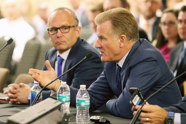 Las Vegas Sands Corporation's Rob Goldstein, right, chief operating officer, speaks near Andy Abboud, vice president of government relations and community development, during a meeting of the Sout ...