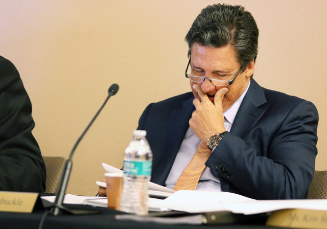 Southern Nevada Tourism Infrastructure Committee member William Hornbuckle, president of MGM Resorts International, looks over paperwork a SNTIC meeting at UNLV's Stan Fulton Building Monday, July ...