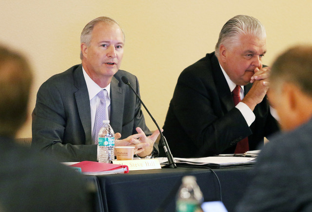 Southern Nevada Tourism Infrastructure Committee Chairman Steve Hill, left, leads a meeting of the SNTIC near committee member Steve Sisolak, chairman of the Clark County Commission, at Stan Fulto ...