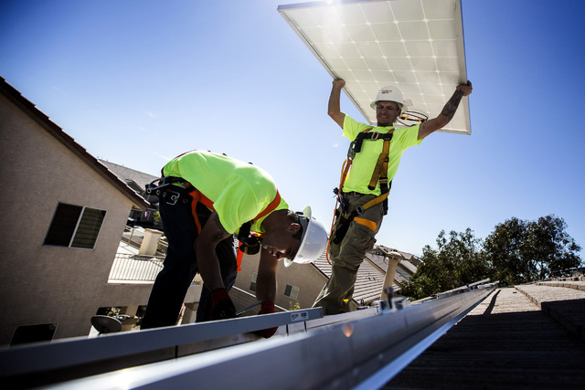 Robco Electric installs solar panels at a home in northwest Las Vegas on Friday March 13, 2015. (Jeff Scheid/Las Vegas Review-Journal)