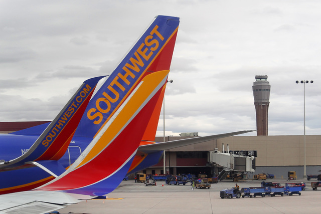 Southwest Airlines jets are lined up at the A Gates at McCarran International Airport Sunday, Feb. 22, 2015. (Sam Morris/Las Vegas Review-Journal)