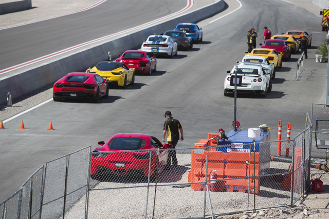 Rows of exotic cars line up in pit row at SpeedVegas, 14200 S. Las Vegas Blvd, on Thursday, July 14, 2016. (Jeff Scheid/Las Vegas Review-Journal) Follow @jeffscheid