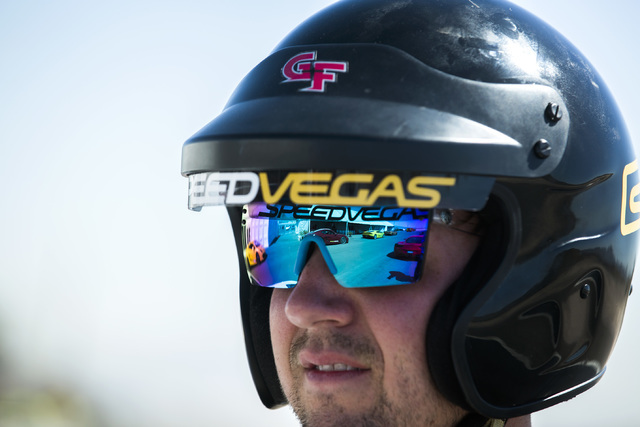 Exotic cars on pit row are seen reflected off the glasses of professional coach Trevor Newman at SpeedVegas, 14200 S. Las Vegas Blvd, on Thursday, July 14, 2016. (Jeff Scheid/Las Vegas Review-Jour ...