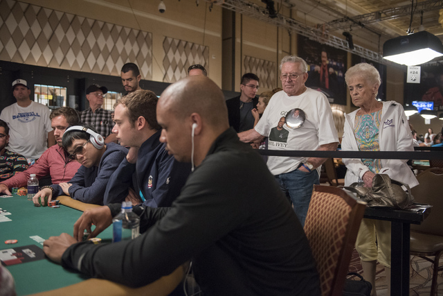 Super fans Mel and Pat Humphries, right, watches their favorite poker player Phil Ivey, foreground center, as he plays in a hand during the Main Event of the World Series of Poker at the Rio Conve ...