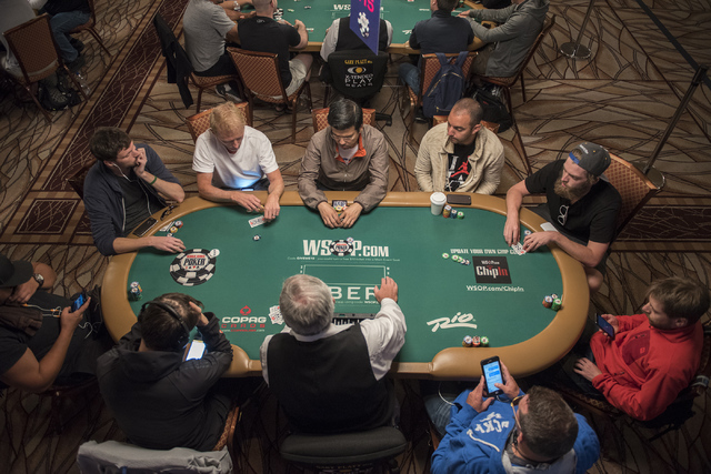 Poker players are seen at the Main Event of the World Series of Poker at the Rio Convention Center in Las Vegas on Monday, July 11, 2016. (Martin S. Fuentes/LasVegas Review-Journal)