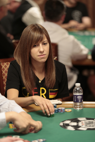 Kristen Bicknell ponders a bet during the Tag Team Poker No Limit Hold'em event at the Rio Convention Center in Las Vegas on Wednesday, July 6, 2016. Donavon Lockett/Las Vegas Review-Journal