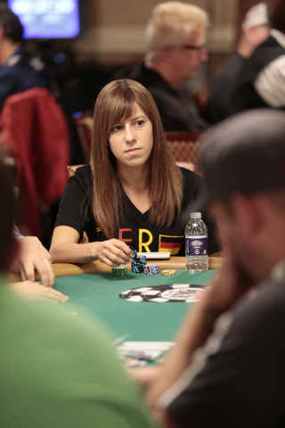 Kristen Bicknell looks across the table while pondering a bet during the Tag Team Poker No Limit Hold'em event at the Rio Convention Center in Las Vegas on Wednesday, July 6, 2016. Donavon Lockett ...