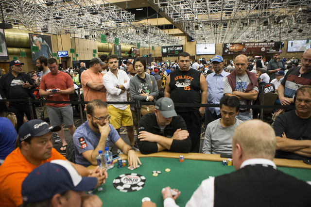 Fans watch a game with professional poker player Daniel Negreanu during a World Series of Poker tournament at the Rio Convention Center on Wednesday, July 13, 2016, in Las Vegas. Erik Verduzco/Las ...