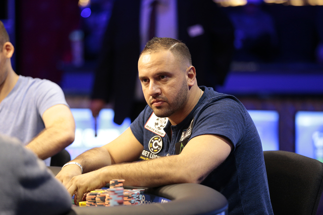 Poker player Michael Mizrachi stares across the table at an opponent, during the $50,000 buy-in Poker Players' Championship at the Rio Convention Center in Las Vegas on Wednesday, July 6, 2016. (D ...