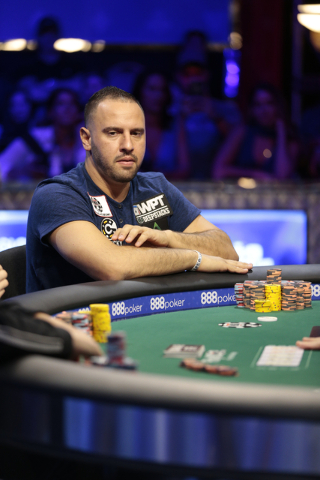 Poker player Michael Mizrachi looks across the table at an opponent during the $50,000 buy-in Poker Players' Championship at the Rio Convention Center in Las Vegas on Wednesday, July 6, 2016. (Don ...