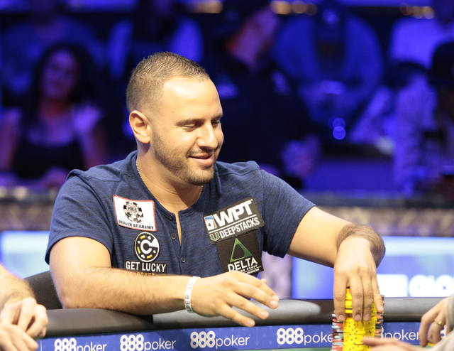 Michael Mizrachi smiles and stacks his chips after winning a hand in the $50,000 buy-in Poker Players' Championship at the Rio Convention Center in Las Vegas on Wednesday, July 6, 2016. (Donavon L ...