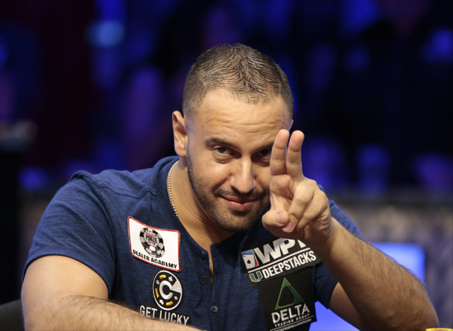 Michael Mizrachi gestures to his fans after winning a hand in the $50,000 buy-in Poker Players' Championship at the Rio Convention Center in Las Vegas on Wednesday, July 6, 2016. (Donavon Lockett/ ...