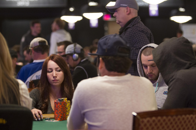 Melanie Weisner, 29, of Houston, Texas, looks at another player as she competes during Day 4 of the Main Event of the World Series of Poker at the Rio Convention Center in Las Vegas on Friday, Jul ...