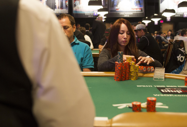 Melanie Weisner, 29, of Houston, Texas, stacks her chips during Day 4 of the Main Event of the World Series of Poker at the Rio Convention Center in Las Vegas on Friday, July 15, 2016. Richard Bri ...