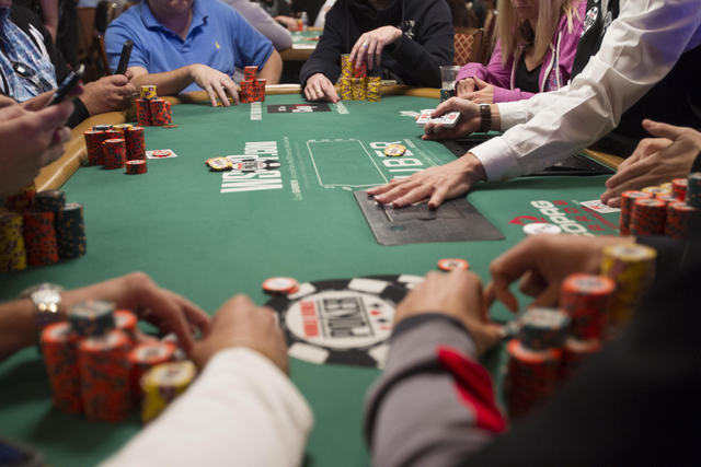 Poker players are seen at a table during Day 4 of the Main Event of the World Series of Poker at the Rio Convention Center in Las Vegas on Friday, July 15, 2016. Richard Brian/Las Vegas Review-Jou ...