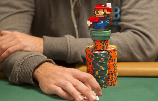 A poker player keeps a charm on his chips during Day 4 of the Main Event of the World Series of Poker at the Rio Convention Center in Las Vegas on Friday, July 15, 2016. Richard Brian/Las Vegas Re ...